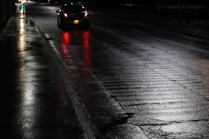 Driving In Rain poem by John Barr